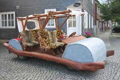 Replica of Fred Flintstone's footmobile.  Engineer Sebastian Trager built the model using the chassis of a Volkswagen Polo. There's no need for Fred Flintstone and Barney Rubble's pedal power however, with the modern adaptation of the Flintmobile boasting a 1.3 litre engine hidden under the front roller.