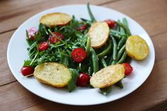 potatoes, green beans, arugula, and cherry tomatoes