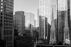 I shot this New York Photo from a room of the Lotte Hotel. I like the juxtaposition of the towers of St. Patricks church with the modern skyscrapers. TITLE: St Patrick, New York MEDIUM: Fine art print (unframed) PRINT SIZES (inches): New York Black And White, Black And White Prints, Paris Snow, Paris Skyline, New York Skyline, New York Cityscape, Philip Glass, Parisian Decor, Modern Skyscrapers