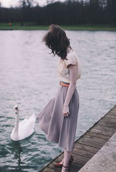 I Love this photo!  The muted colors - and the swan!  Also, like the blouse and…