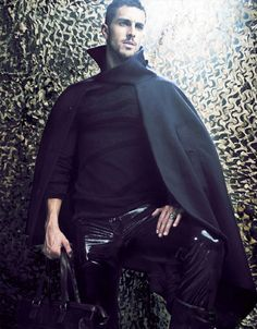 He's a male model by day and a fashion hero by night. Flying through the starry skies in his wool cape and spandex leather pants