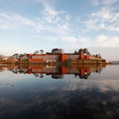 Tasmania's MONA (Museum of Old and New Art) sits largely hidden in the cliffs. #Australia