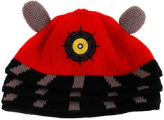 Dalek Beanie - A red top with black and gray striped bars going downwards near the bottom. Up top there are two gray antennas and a small circular eye in the centre on the front. I chose this beanie because Doctor Who is one of my favourite tv shows.