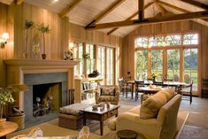 living room, family room, dining area open concept, wood walls, high beamed ceiling fireplace