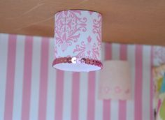 This one is a paper tube with holes punched out and sequined trim glued around the bottom edge.