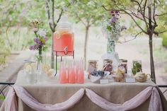Love the burlap table cloth, already poured pink lemonade, and pink accent