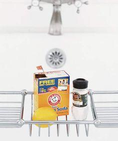 Baking soda, lemon and cream of tartar by a bathtub
