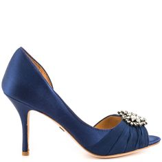 The Pearson will add a pretty touch to any dress.  This gorgeous look by Badgley Mischka features a navy satin upper with D'orsay silhouette and brooch embellished vamp.  The peep toe pump is perfected by a low 3 1/2 inch heel.