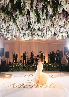 Photographer: Victor Sizemore Photography; Romantic ballroom wedding reception with green and floral ceiling decor