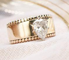 Custom 14k gold Wedding Ring with Pear-shaped Diamond.