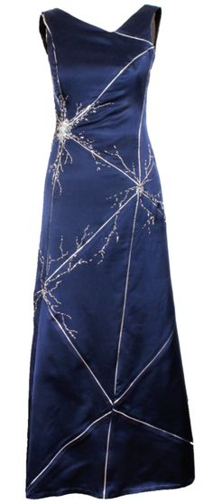 This is the dress worn by this year's Nobel Prize laureate May Britt Moser. The design, created by Matthew Hubble, is inspired by her work on grid neurons. The pattern shows a neuron grid with beading in the shape of three large neurons complete with the soma (the body that contains the nucleus) and nerve fibers.