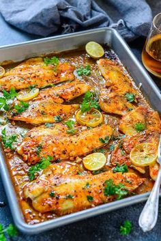 Healthy Meals baked tilapia o a baking tray along with a glass of wine - This Spicy Lemon Garlic Baked Tilapia takes all of 5 minute of preparation time before you pop it in the oven. Baked Tilapia Fillets, Tilapia Fillet Recipe, Halibut And Rice Recipe, Basa Fillet Recipes, Redfish Recipes, Oven Baked Tilapia, Baked Fish Fillet, Comida Keto, Healthy Eating Recipes