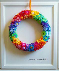 "felt flowers embellished with fabric paint on felt wrapped straw wreath, 19"""