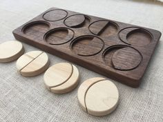 Present your child with the wonder of the moon as they explore its phases with this puzzle. Each puzzle is made to order, with attention to heirloom quality and beautiful feel. It is crafted from solid hardwoods walnut and maple, allowing their natural colors to shine through envisioning