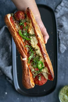 These mouth watering baked meatball subs are completely vegan! Stuffed with easy chickpea meatballs, marinara, pesto, and homemade vegan mozzarella. Vegetarian Recipes, Cooking Recipes, Cooking Tips, Vegan Meatballs, Hot Dog Recipes, Le Diner, Hamburgers, Vegan Dishes, Meatball Subs