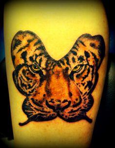 Justin winter tiger butterfly tattoo