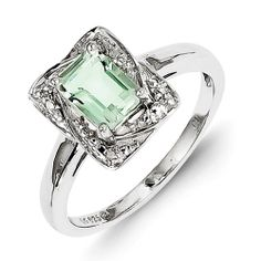 Who wouldn't want this dazzling Sterling Silver Diamond & Green Amethyst Ring on their fingir??