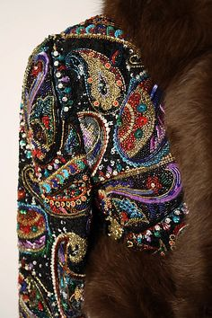 Detail of the embroidery on the evening bolero by Oscar de la Renta.