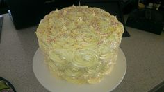 Red velvet cake layered with vanilla buttercream and covered in white chocolate italian meringue