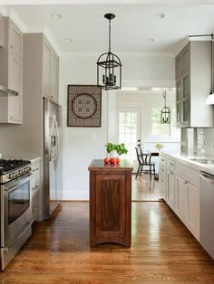Make the Island Fit the Space  - 20 Dreamy Kitchen Islands on HGTV.  I like the skinnier island idea.