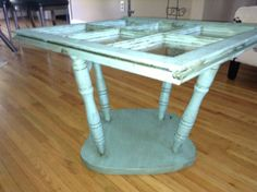 Rustic Blue coffee table ~ Love the use of an old chair bottom as a base.