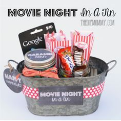 A Gift In a Tin: Movie Night in a Tin - Melissa Williams - A Gift In a Tin: Movie Night in a Tin Gift basket idea: A movie night in a tin! Includes free printable tags and labels. Movie Basket Gift, Movie Night Gift Basket, Movie Gift, Popcorn Gift, Diy Cadeau, Diy Gift Baskets, Jar Gifts, Food Gifts, Diy Christmas Gifts