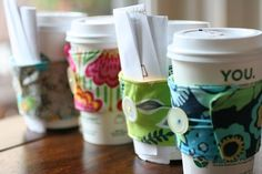 Teacher Gifts - Coffee cozies around cups filled with thank you note and coffee gift card.