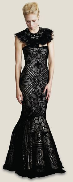 I hope that one day I get to wear a dress like this....the ones I typically can afford are never as insane as the one pictured here. Designer: Martha Medeiros.