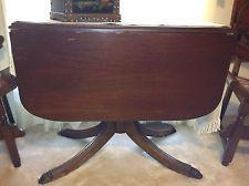 antique mahogany drop leaf table, metal claw feet tips