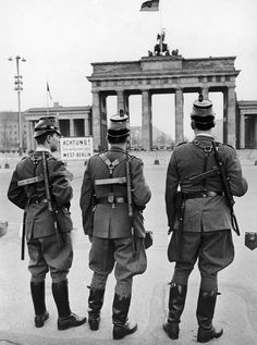 West German police wearing British machine guns which they were provided with for the first time stand in front of the Brandenburg Gate, near the sector border in Berlin, Germany on October (AP Photo/Werner Kreusch) West Berlin, Berlin Wall, East Germany, Berlin Germany, German Uniforms, Military Uniforms, German Police, Brandenburg Gate, European Summer