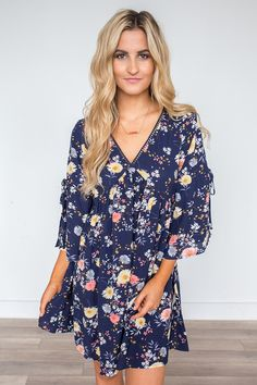 Shop our Floral Print Peasant Dress. Available in blush and navy. Featuring bell sleeves and a crochet trim. Always free shipping on all US orders!