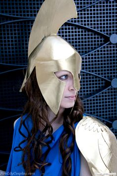 """""""The helmet is my favorite part of the whole costume! I started with a cardboard skeleton for the helmet frame, then built up the face mask, horsehair ridge and back guard with more cardboard. Everything was covered in several layers of masking tape, then several layers of paper mache, then gesso. I sanded the whole helmet smooth ...All props were spray painted gold with Rust-oleum Metallic Gold spray paint """""""