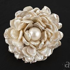 What a divine freshwater cultured pearl brooch!  Baroque-shaped freshwater pearls tend to have very good to excellent luster; I find them to be very pleasing, indeed.