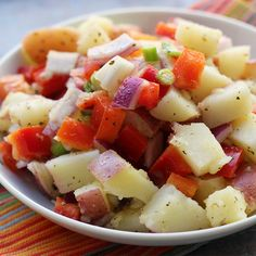 Potatoes tossed in vinaigrette instead of a mayonnaise dressing make a perfect side dish for hot weather picnics and barbecues.  Photo credit: Joanne Bruno from Eats Well with Others.