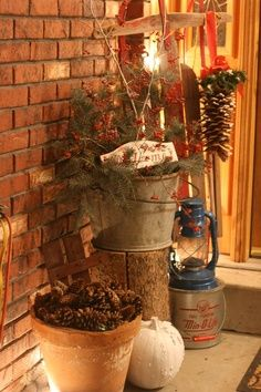 Rustic porch decor. LOVE the galvanized bucket on porch raised on top of a tree log. Could fill bucket with mums, pine cones or change with the holiday.