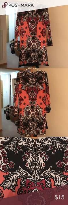 A sassy but classy dress. Never been worn!! Can be worn for casual day out or a day at the office. Paisley/Floral print. Cute with any kind of shoes! Colored navy, pink/peach, white and violet. H&M Dresses Midi