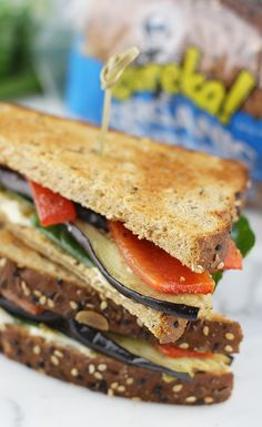 Mediterranean Veggie Club: All your favorite Mediterranean flavors are invited to this club...sandwich, that is. Toasted eureka! Grainiac Organic Bread holds together layers of roasted eggplant and red pepper, fresh spinach, pesto and goat cheese.
