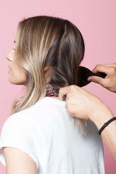 To begin, brush your hair with a boar or nylon brush to distribute any hair oils and leftover product through the hair. Tran uses Mason Pearson's Handy Mixture Brush, or try Sonia Kashuk's Hair Brush for a similar finish. #refinery29 http://www.refinery29.com/anh-co-tran-layered-long-bob#slide-15