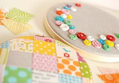 Hoops and buttons go together so well. Pretty buttons scattered on a natural base and hoop framed - on flickr