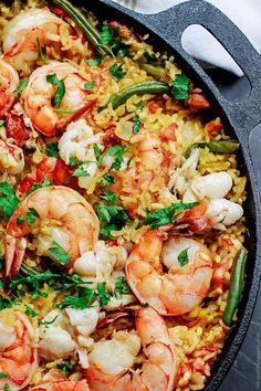 Easy Seafood Paella from The Mediterranean Dish! This one-pan-wonder will satisfy and totally impress your guests! Pin it now.