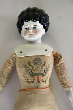 China head early american doll with muslin body printed with eagle