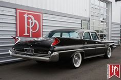 Classic 1960 Chrysler Windsor finished in Formal Black with Blue interior. Odometer shows miles. Chrysler Windsor, Chrysler Models, Blue Options, Rear Speakers, Door Switch, Sedans, Rear Seat, Colorful Interiors, Showroom