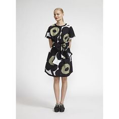 Trends are fun, but classics like this one never go out of style. Marimekko Mae Black/White/Green Unikko Dress - $325.00