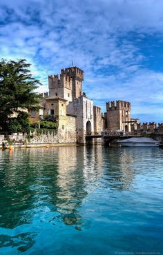 Scaliger castle from moat reflection italy garda lake
