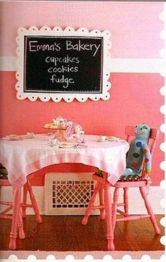table with chalkboard frame...higher chari rail....love the two toned pink paint!