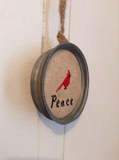zinc Mason jar lid ornament. Cross stitch pattern from http://ourpioneerhomestead.blogspot.ca/2012/12/free-ornament-patterns-christmas.html
