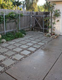 along the side of the house with garden bordering the house - square pavers and rock