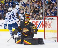953b8b3a4da Toronto Maple Leafs  15 Pierre-Alexander Parenteau celebrates the Leafs  goal on Vancouver Canucks