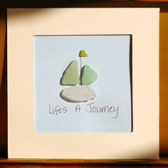 Sea glass sailboat  @  New Beginnings Sea Glass (facebook)