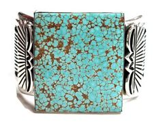 I love number 8 turquoise. It is a rare stone. This is an example of it. It is available at Perry Null Trading Co in Gallup New Mexico for a mere: $2205.00